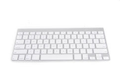 Apple wireless keyboard. A wireless computer keyboard from Apple for Mac and Macbooks, isolated on white background Royalty Free Stock Image