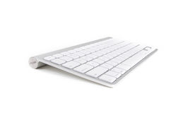 Apple wireless keyboard. A wireless computer keyboard from Apple for Mac and Macbooks, isolated on white background Stock Photo
