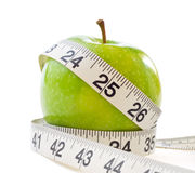 Apple With Measuring Tape Royalty Free Stock Photography