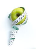 Apple With Measuring Tape Royalty Free Stock Images