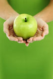 Apple in woman hands Stock Photo