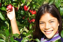 Apple woman smiling outside Stock Image