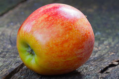 Apple on wood Royalty Free Stock Images