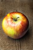 Apple  on wood. Apple on an old wood Royalty Free Stock Photography