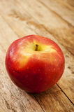 Apple on wooden background Stock Images