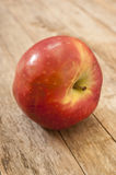 Apple on wooden background Royalty Free Stock Photo