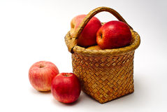 Apple in wooden basket. On white royalty free stock image