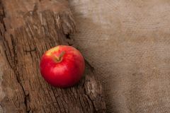 Apple on wooden board Stock Photography