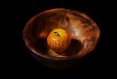Apple in a wooden dish Royalty Free Stock Photography