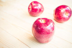 Apple on the wooden floor Royalty Free Stock Photos