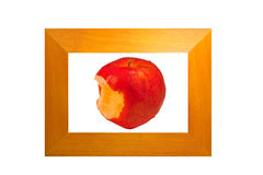 Apple in a wooden frame. As a concept in keeping with the taste of the region Royalty Free Stock Image