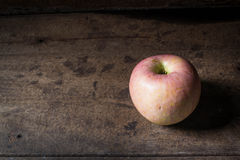 Apple on wooden Stock Images