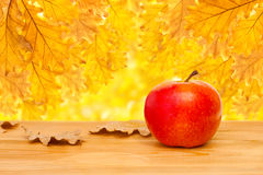 Apple on a wooden table Stock Photography