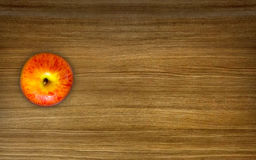 Apple on wooden table. Apple on dark wooden table top view Stock Photo