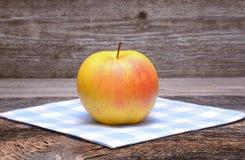 Apple on wooden table Stock Photo