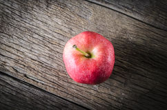 Apple on wooden table Royalty Free Stock Images