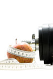 Apple wrapped around with measuring tape Royalty Free Stock Image