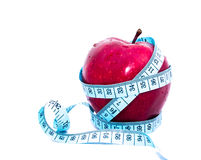 Apple wrapped centimeter. Stock Photo