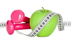 Apple wrapped in measuring tape Royalty Free Stock Image