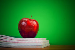 Apple on writing-books Stock Images