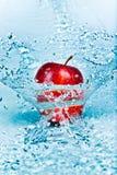 Apple y agua Fotografía de archivo