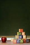 Apple y bloques de madera Imagen de archivo libre de regalías