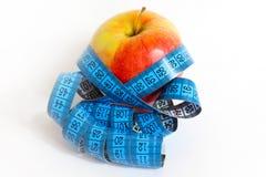 Apple y cinta de la medida Foto de archivo libre de regalías