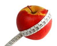 Apple y cinta de medición Foto de archivo libre de regalías