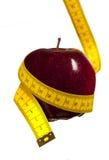 Apple y cinta métrica Foto de archivo libre de regalías