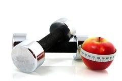 Apple y dumbels Foto de archivo libre de regalías