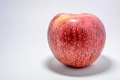 Apple y fondo blanco Imagen de archivo