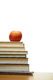 Apple y libros Imágenes de archivo libres de regalías
