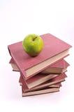 Apple y libros Imagen de archivo libre de regalías