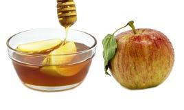 Apple y miel aislados en blanco Imagen de archivo
