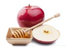 Apple y miel aislados en el fondo blanco Imagenes de archivo