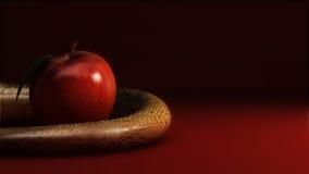 Apple y serpiente Imagen de archivo