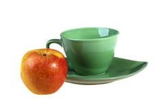 Apple y taza Fotografía de archivo