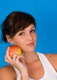 Apple y una muchacha Imagen de archivo libre de regalías