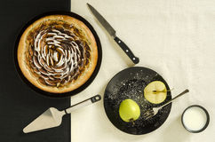 Apple yeast pie with cinnamon and sugar on black plate Stock Images