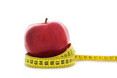 Apple with yellow measuring tape Royalty Free Stock Photography