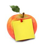 Apple with yellow note royalty free stock photography
