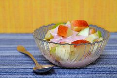 Apple and yogurt in bowl Royalty Free Stock Photography