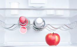 Apple, yogurt and two bottles Royalty Free Stock Photography