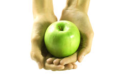 Apple in young woman hands stock photography