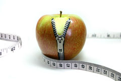 Apple Zip. Apple with a zipper down the front. Has a tape measure around its middle, Great to illustrate weight loss and dieting. The apple zipper has the word Royalty Free Stock Images