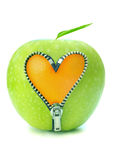 Apple zip. Orange underneath an apple through a heart shaped zipper Stock Photos