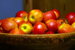 Applebowl. A wooden bowl filled with red apples Royalty Free Stock Photo