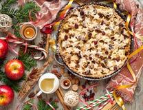 Appleon de la Navidad un tablero de la mesa rústico Fotografía de archivo