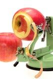 Appler Schäler mit dem Apfel mit zwei Rottönen Lizenzfreies Stockbild
