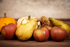 Apples and üears on a table as rustical background Stock Image